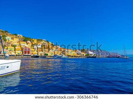Panoramic view of the pictorial harbor of Symi island in Greece