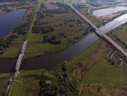 Panoramic view of the railway and road bridge over the river. Aerial photos