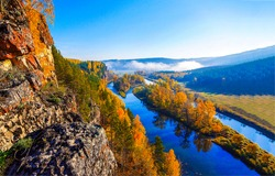 Panoramic view of the river valley in autumn. Autumn river in mountain valley. Autumn river valley panorama. River valley in autumn