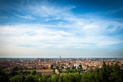 Panoramic view of the roofs of Bologna with blue sky.