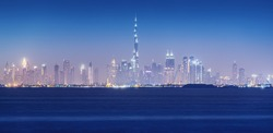 Panoramic view of the skyline of the futuristic city of Dubai with all the familiar outlines of skyscrapers. Vacation and real estate in UAE