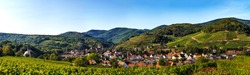 Panoramic view of the stunning village of Andlau in Alsace. Slopes with ripening grapes. Great views of the Vosges mountains. Idyll and grace.