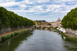 Panoramic view of Tiber river with Saint Peter's Dome at distance in Rome, Italy