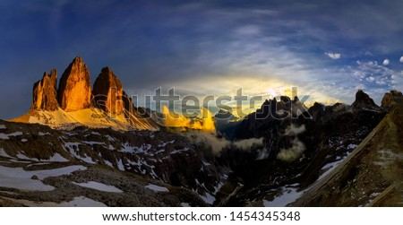 Panoramic view of Tre Cime mountain at sunrise, Tre Cime di Lavaredo National Park, Dolomites, Italy #1454345348