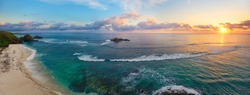 Panoramic view of tropical beach with surfers at sunset, Kuta, Lombok island. Indonesia