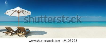 Panoramic view of two chairs and white umbrella on the beach. Banner, lots of copy space #19103998