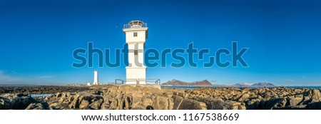 Panoramic view of two lighthouses at end of peninsula coastline of Akranes town in Iceland, one active and another inactive