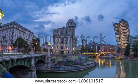 Panoramic view of Urania with other buildings and Danube Canal day to night transition timelapse in Vienna. Urania is a public educational institute and observatory Zdjęcia stock ©