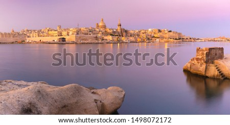 Panoramic view of Valletta Skyline with churches of Our Lady of Mount Carmel and St. Paul's Anglican Pro-Cathedral at sunset as seen from Sliema, Valletta, Capital city of Malta Stock photo ©