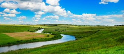Panoramic view of valley of river Upa in Tula region,Russia.Peaceful summer landscape with green hills,beautiful woods,meadows,river curves and fields.
