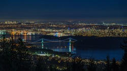 Panoramic view of Vancouver cityscape at night, British Columbia, Canada.
