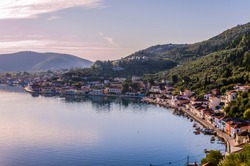 Panoramic view of Vathi capital and main port of Ithaka island in the background the mountains that surround it