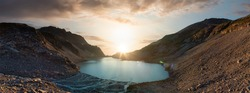 Panoramic View of Vibrant Colorful Glacier Lake up in Rocky Mountains in Canadian Nature Landscape. Sunny Sunset Art Render Sky. Wedgemount Lake Hike in Whistler, BC, Canada. Background Panorama