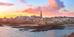 Panoramic view of walled city Saint-Malo with St Vincent Cathedral at sunrise. Saint-Maol is famous port city of Privateers is known as city corsaire, Brittany, France