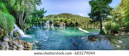 Panoramic View of waterfall Skradinski Buk in Krka National Park one of the most famous national parks and visited by many tourists.Skradinski Buk:KRKA NATIONAL PARK,CROATIA,MAY 27,2017 Сток-фото ©