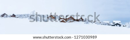 Stock Photo Panoramic view of winter landscape with snow covered trees and wooden cabins in Beitostolen. Winter in Norway