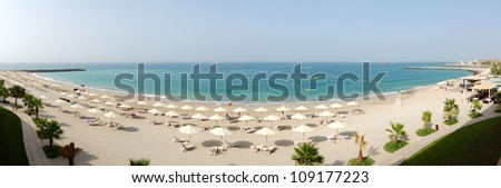 Panoramic view on a beach and turquoise water of the luxury hotel, Fujairah, UAE
