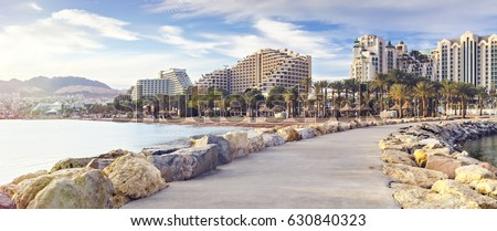 Panoramic view on a public beach of Eilat - famous resort and recreation city of Israel #630840323