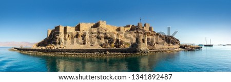 Panoramic view on an ancient Fortress of Saladin on the Pharaoh Island in the Gulf of Aqaba. Old Castle of Sultan Salah ad-Din in Taba, travel on Sinai and sea vacation on the Red Sea. Stock fotó ©