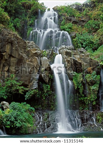 Panoramic view on beautiful waterfall in Reunion Island