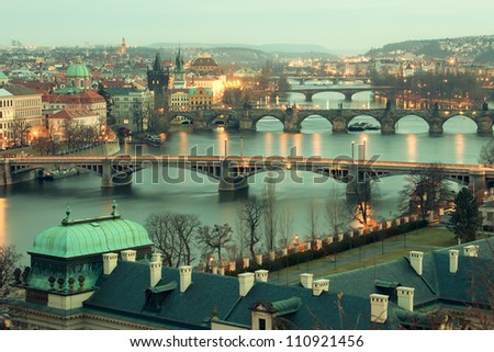 Panoramic view on Charles bridge and evening Prague.  Beautiful famous place in Bohemia