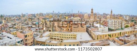 Panoramic view on historical Islamic neighborhood with residential houses and medieval mosques and mausoleums, Cairo, Egypt #1173502807