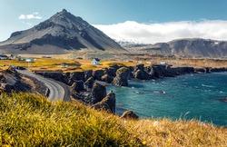 Panoramic view on Impressive Icelandic seascape. Majestic Stykkisholmur rocky fjords at sunset. Snaefellsnes peninsula. Amazing Iceland. Arnarstapi village popular travel and hiking destination place