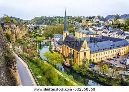 Panoramic view on Luxembourg City. Alzette river, church of St Jean du Grund and Abbey de Neumunster. #502568368