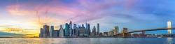 Panoramic view on Manhattan and Brooklyn bridge at sunset, New York City