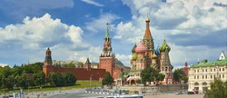 Panoramic view on Moscow Red Square Kremlin towers Clock Kuranti, Saint Basil's Cathedral church. Moscow architecture. Russia Moscow Red Square sightseeing holidays vacation famous tours. Brick castle