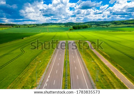 Panoramic view on road ending in the field, blind street. Concept of a difficult, crisis situation with no way out. Idea of deadlock, no-win clinch, collapse or stalemate due to stagnation Сток-фото ©