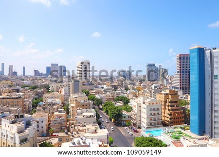 Panoramic view on roofs of old Tel-Aviv (Israel) on the modern buildings background