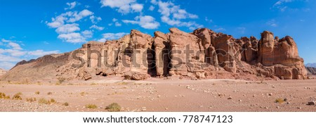 Panoramic view on stone pillars of the King of Solomon in geological Timna park that combines beautiful scenery with unique geology, variety of sport and family activities, Israel