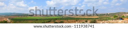 Panoramic view on the agricultural valley and monastic hill of Monastery of the Silent Monks at Latrun (Israel)