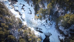 Panoramic view on the river to Chutes Dorwin (waterfall Dorwin),  winter landscape with snow and trees near the city of Rawdon, Quebec Canada
