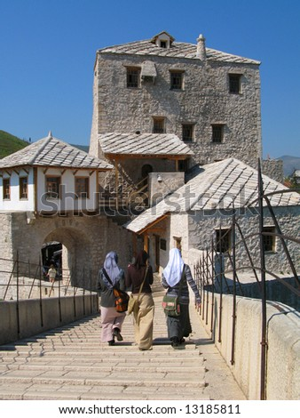 Panoramic view on tower and old houses from the middle of the Old bridge, Mostar, Bosnia - stock photo