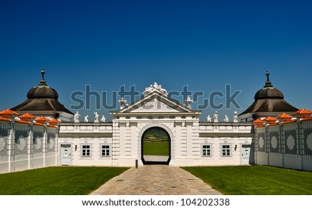 panoramic view out of a white baroque gate