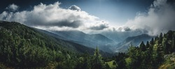panoramic view over a mystical valley in the wild Retezat National Park, Romania