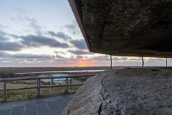 Panoramic view over Dunes of Texel National Park at sunset seen from the opening in the Den Hoorn Battery, Texel, The Netherlands, bunker battery part of Stelling of Den Helder built by the Dutch