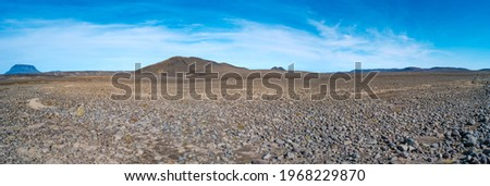 Panoramic view over Icelandic landscape of the deadliest volcanic desert in Highlands, with stones and rocks thrown by volcanic eruptions and hiking trek along the off road, Iceland, summer, blue sky Photo stock ©