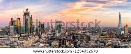 Panoramic view over the modern skyline of London: from the City to the Tower Bridge, just after sunset