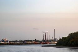 panoramic view over the rhine to the bank with the industrial plant in Wesseling, morging shot