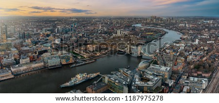 Panoramic view over the skyline of London during sunset time: from the Tower Bridge along the Thames to Canary Wharf