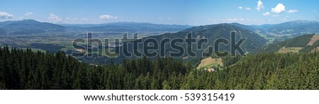 Stock Photo Panoramic view over the Styrian Murtal and the surrounding mountains. F1 and MotoGP racetrack Red Bull Ring racing in Spielberg seen from above on Tremmelberg.