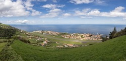 Panoramic view over the village of Santa Cruz das Flores, as the sky is clear it is possible to see the island of Corvo. From the viewpoint of Monte das Cruzes. Flores Island.