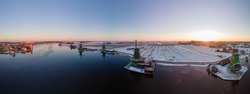 panoramic view over the Zaanse Schans windmill village snow covered during winter, Zaanse Schans wind mills historical wooden mills in the Netherlands. Europe