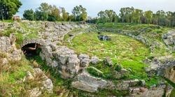 Panoramic view Roman Amphitheatre (Anfiteatro Romano) ruins. Sicily, Italy