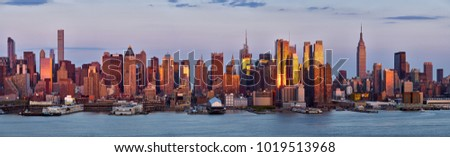 Panoramic view, skyscrapers of Midtown Manhattan at sunset with the Hudson River. New York City #1019513968