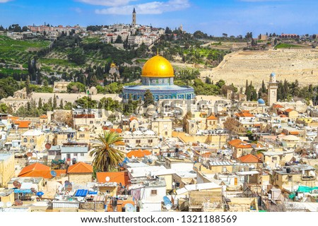 Panoramic view to Jerusalem Old city and the Temple Mount, Dome of the Rock and traditional living houses, the Mount of Olives from the church of the Redeemer. Israel
