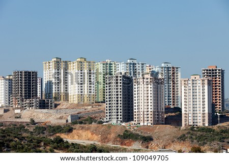 panoramic view to modern buildings under construction